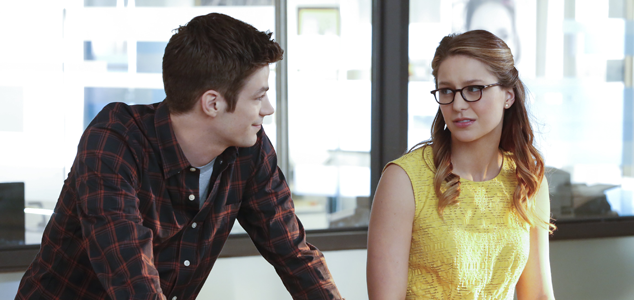 Guest star Grant Gustin as Barry Allen (aka The Flash) and Melissa Benoist as Kara Danvers (aka Supergirl).